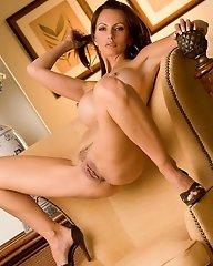 Catalina Cruz relaxes in a chair to masturbate